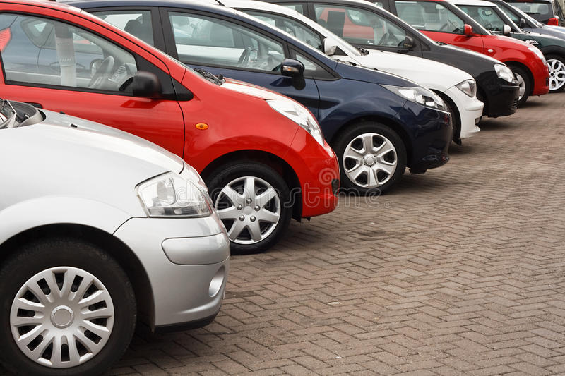 Used car sales. Row of different european marques of used cars for retail sale on a motor dealers forecourt all logos removed stock image