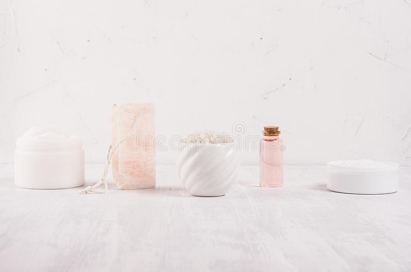 Row of different white and pink spa products for body and skin care as elegance fashion cosmetic background, copy space. Row of different white and pink spa royalty free stock photography