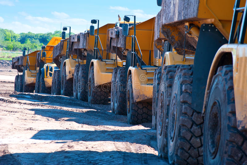 Row Of Dump Trucks Stock Images