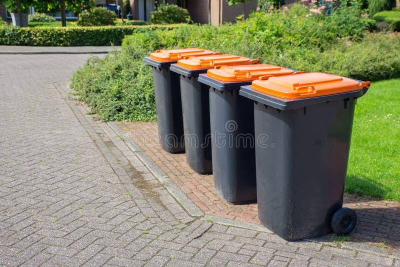 Row of dutch grey waste bins along street. Row of european grey waste bins along street royalty free stock photos