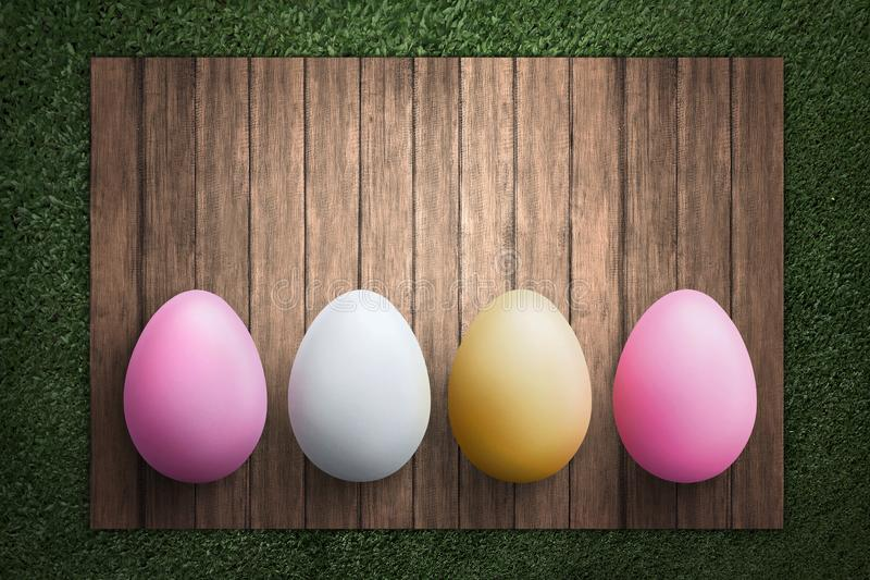 Row of Easter eggs on wooden plank royalty free stock photos
