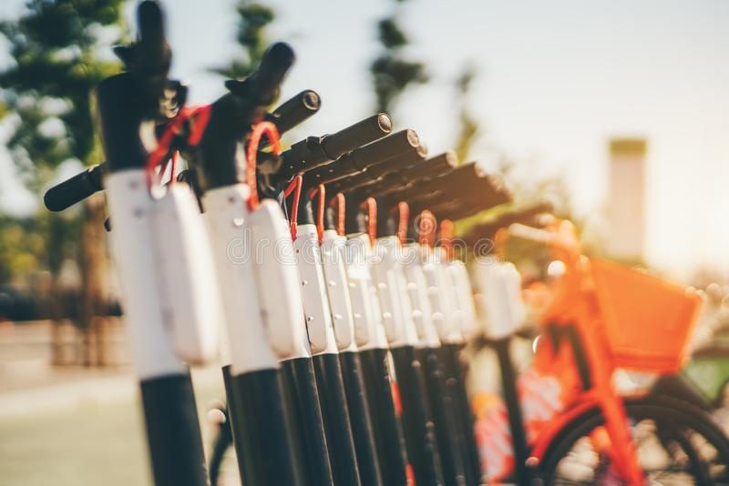 A row of electric scooters outdoors stock images