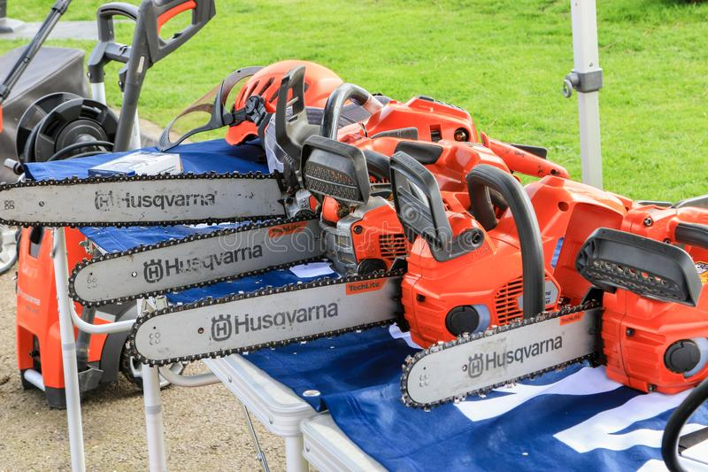 A row of electrical petrol chainsaws stock photo
