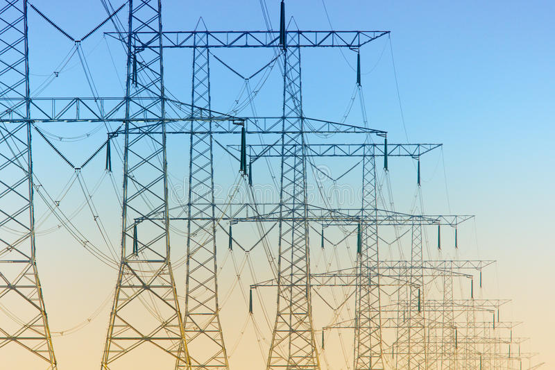 Row of electricity pylons stock photography