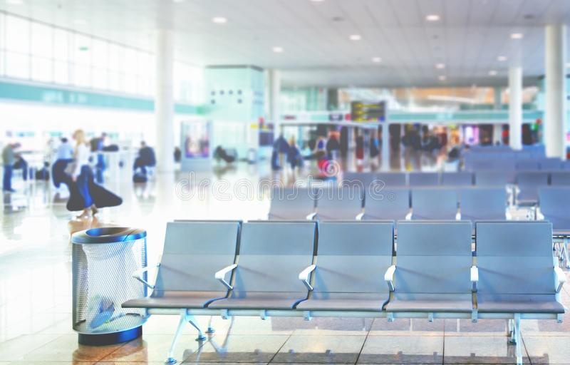 Row of empty chairs in the departure lounge of an international airport stock photography