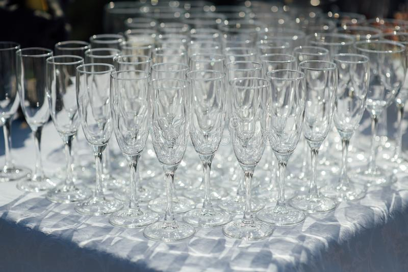 A row of empty champagne glasses on table. Banquet setting royalty free stock image