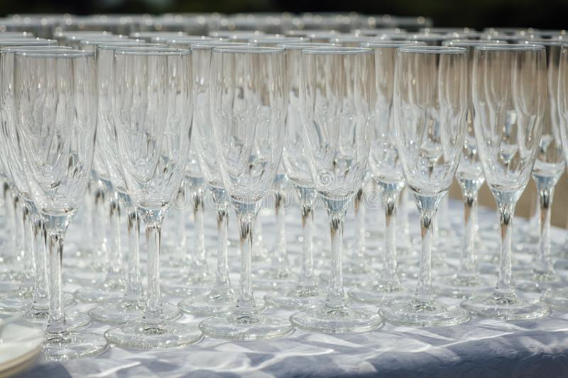 A row of empty champagne glasses on table. Banquet setting stock photos