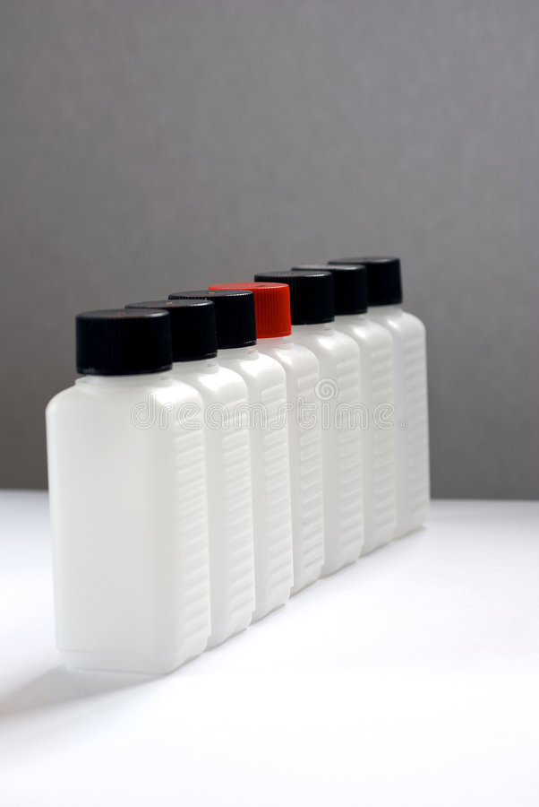 Download A Row Of Empty Plastic Bottles 3 One With Red Cap Stock Photo - Image: 9182298