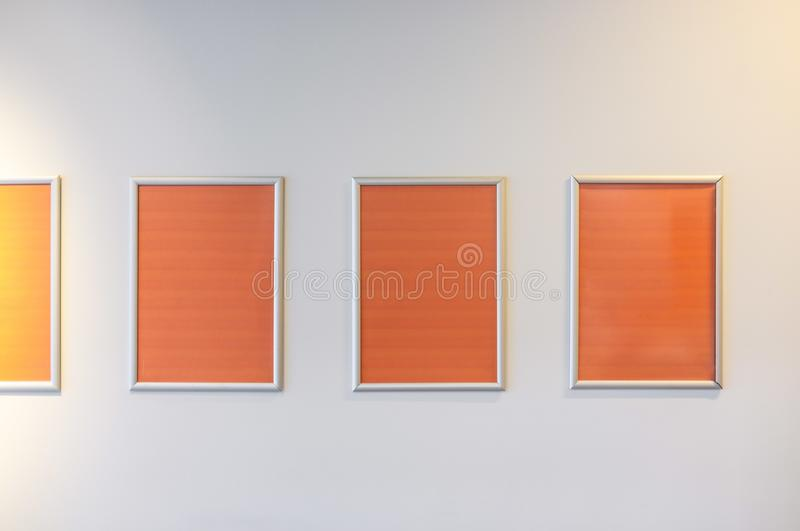 Row of empty vertical picture frames. stock photo
