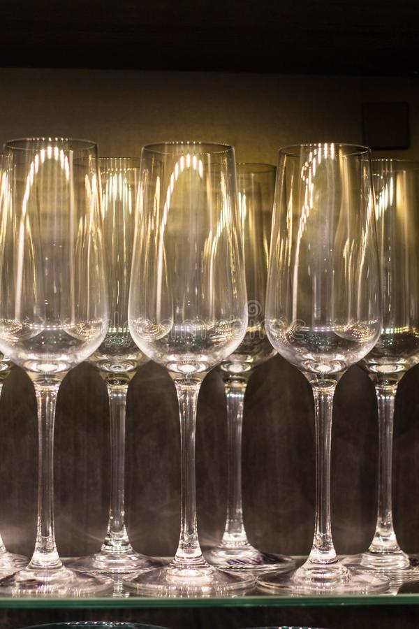 Row of empty wine glasses on bar counter.  royalty free stock image