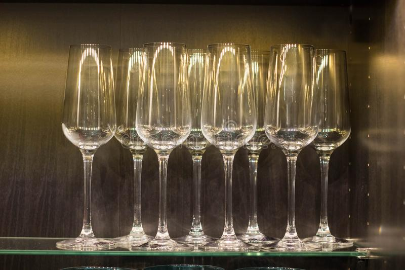 Row of empty wine glasses on bar counter.  stock image