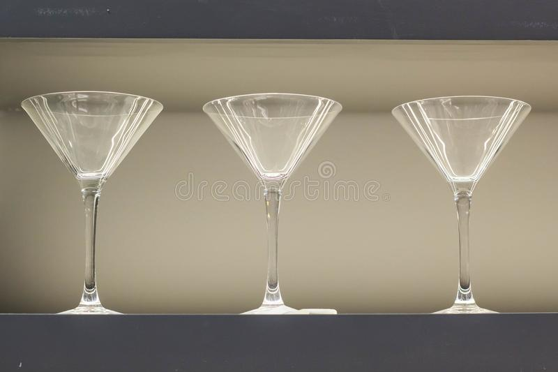 Row of empty wine glasses on bar counter.  royalty free stock photos
