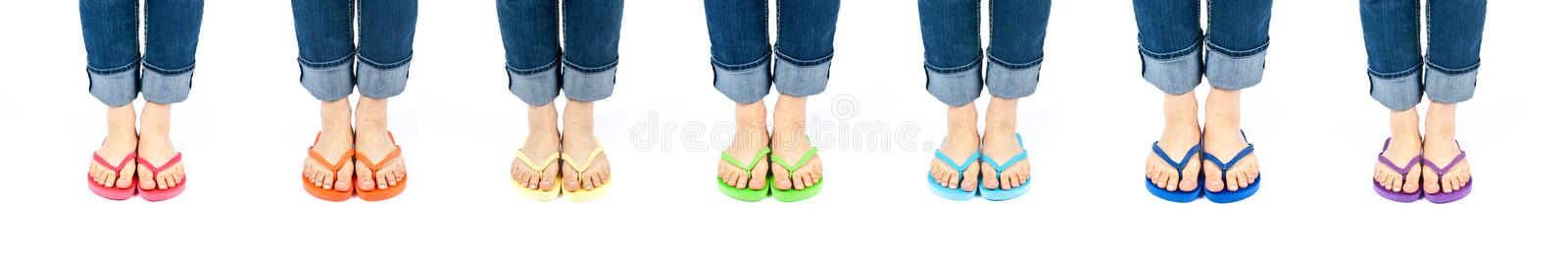 Download Row Of Feet Wearing Colorful Flip Flops Stock Image - Image: 19504927