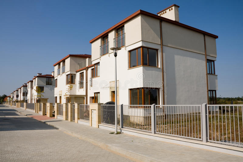 Row of few new houses stock images