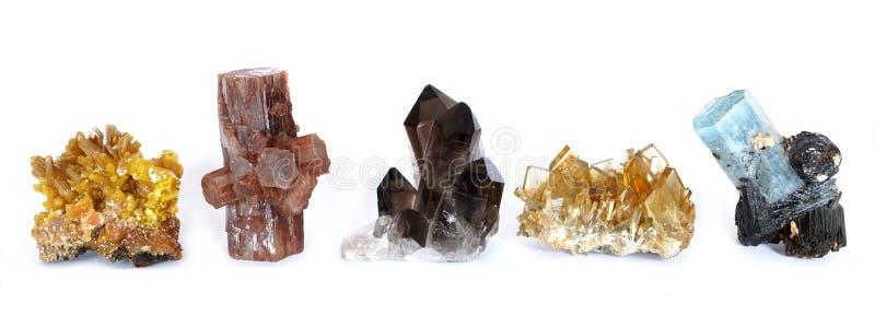 Mimetite, Aragonite, Smoky Quartz, Baryte and Aquamarine with Tourmaline crystals. royalty free stock image