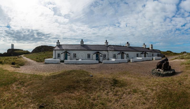 Pilots Cottages Llanddwyn Island. The row of four small cottages on Llanddwyn Island was built for the pilots who helped boats navigate into the ports along the royalty free stock photography