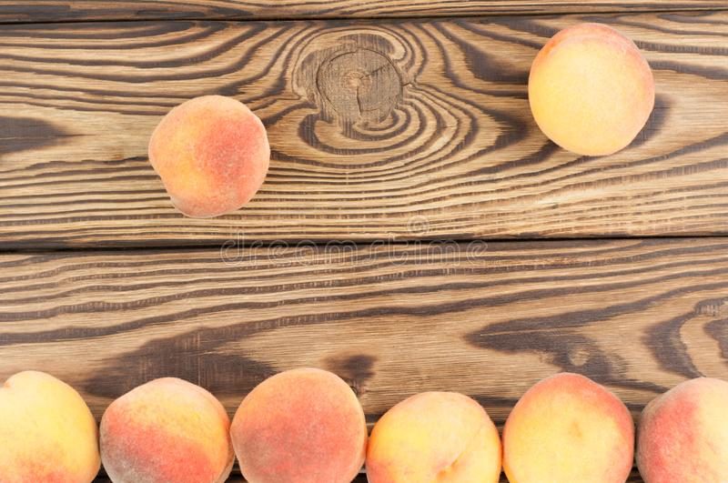 Row of fresh whole ripe peaches and two peaches separately stock photos