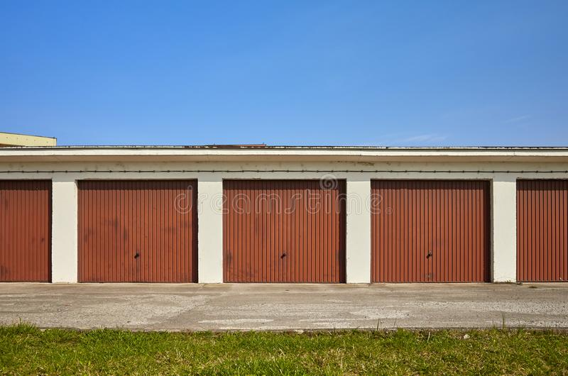 Row of garages with closed gates. royalty free stock photos