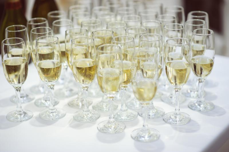 row of glasses filled with champagne royalty free stock photo