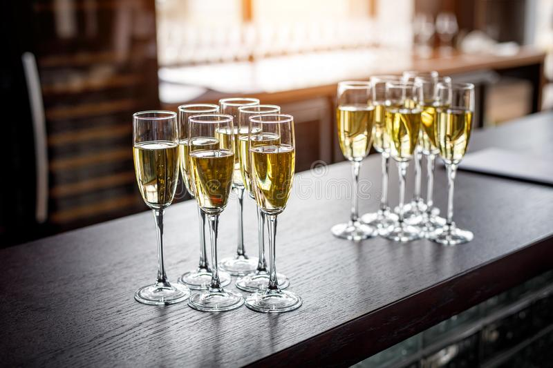 Row of glasses filled with cold champagne.  stock images