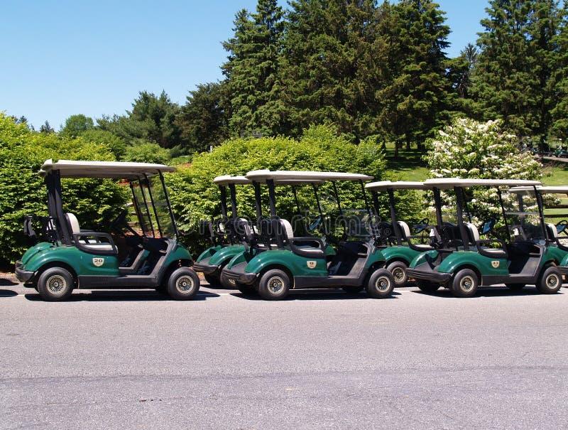 Row of golf carts stock photos