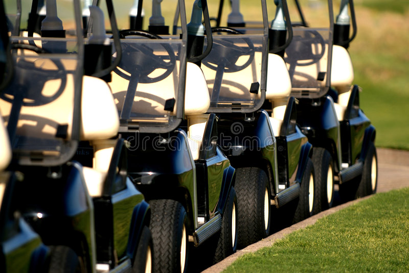 Row of golf carts from front view stock photo