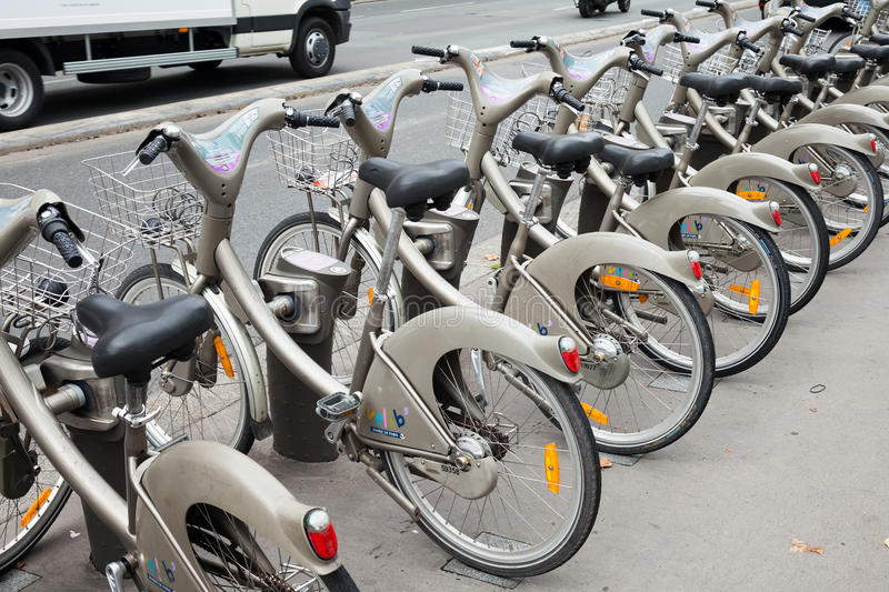 Row of gray city public bicycles for rent royalty free stock photos