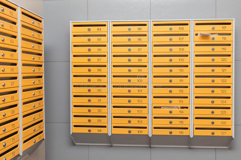 Rows of metal mailboxes stock image