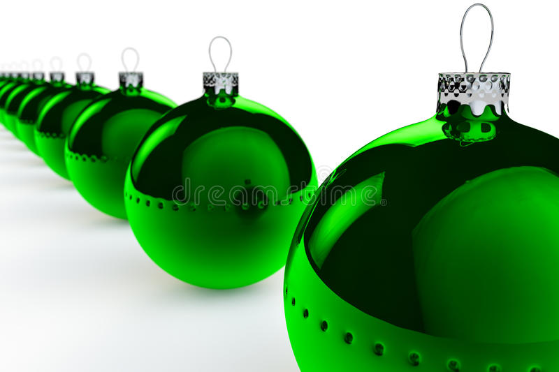 Row of Green Christmas Baubles. A row of green Christmas baubles with a shallow depth of field set against a white backgorund royalty free illustration
