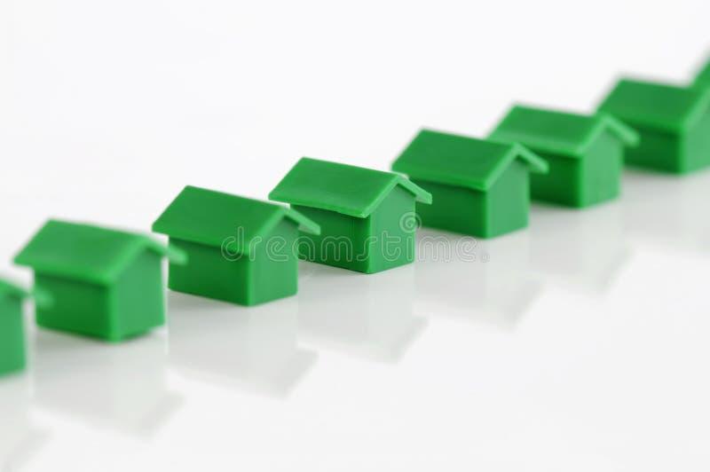 Row of green model houses stock photo