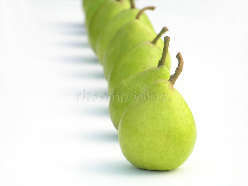 Row of green pears stock image