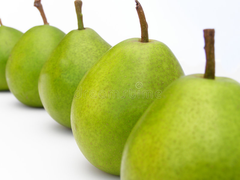 Row of green pears royalty free stock images