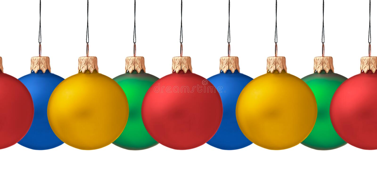 Row of hanging Christmas baubles royalty free stock photos