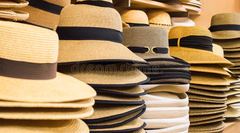 Row of hats on shelves. Row of colorful sunhats and Panama hats on shelves in a shop royalty free stock photos