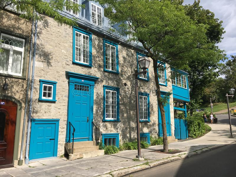 Row of historic houses, Quebec City. Row of historic houses with blue doors and shutters, Quebec City Canada stock images