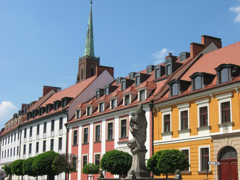 Row of historical buildings with tiled roofs and mansard windows stock image