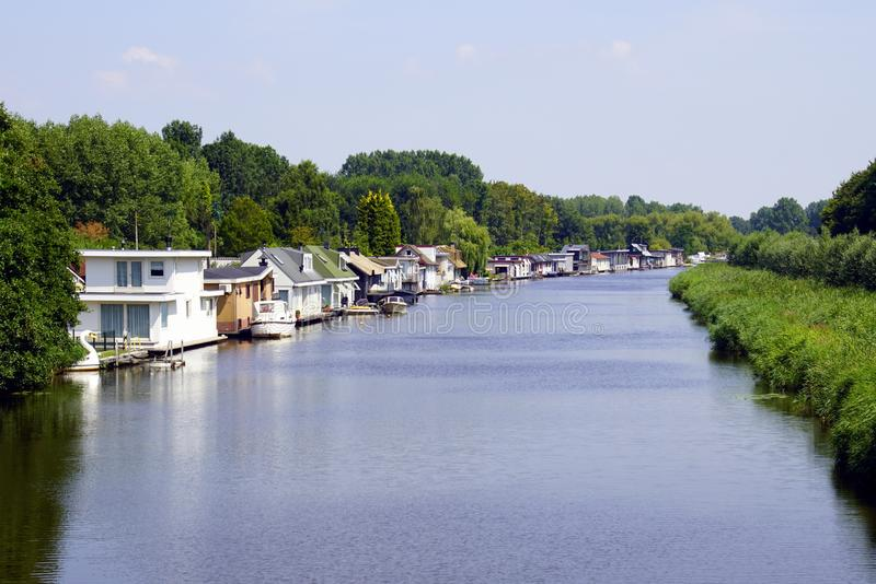 Row of houseboats. A row of Dutch houseboats in the city of Almere stock photos