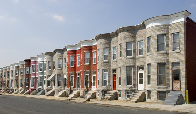 Row Houses. Colorful row houses along a residential street in Baltimore with painted brick and formstone facades and marble stoops
