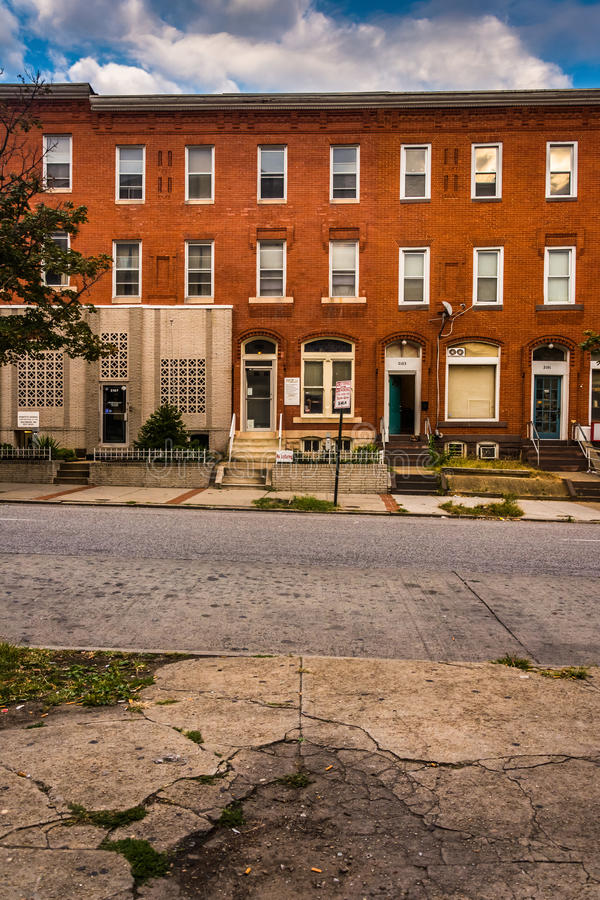 Row houses and cracked sidewalk in Baltimore, Maryland. royalty free stock photos
