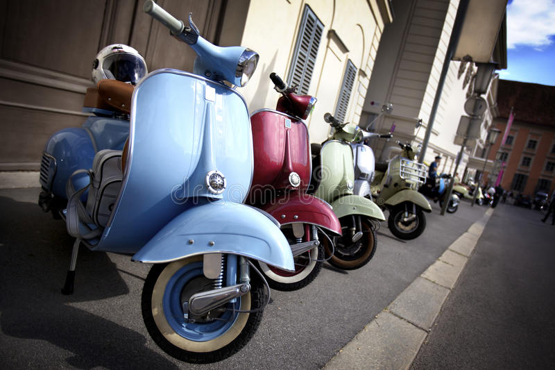 Row of Italian mopeds parking stock photos