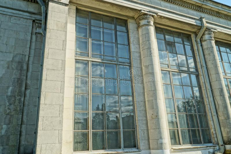A row of large old windows on a gray stone wall royalty free stock photo