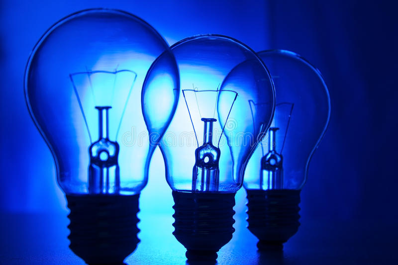 Row of light bulbs on a bright blue background royalty free stock photos