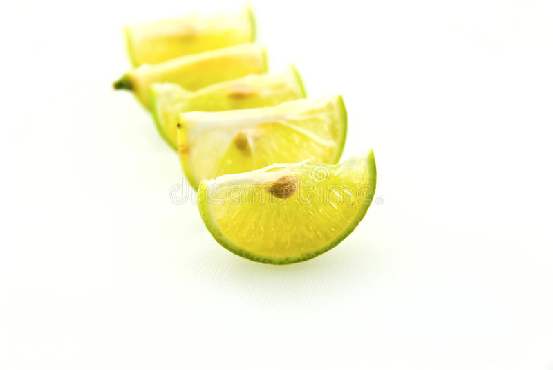 Row of lime slices. A row of lime slices stock images