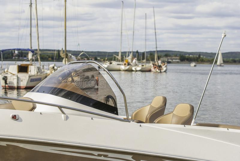 A beautiful view of the moored yachts at the shore on a sunny day stock photos