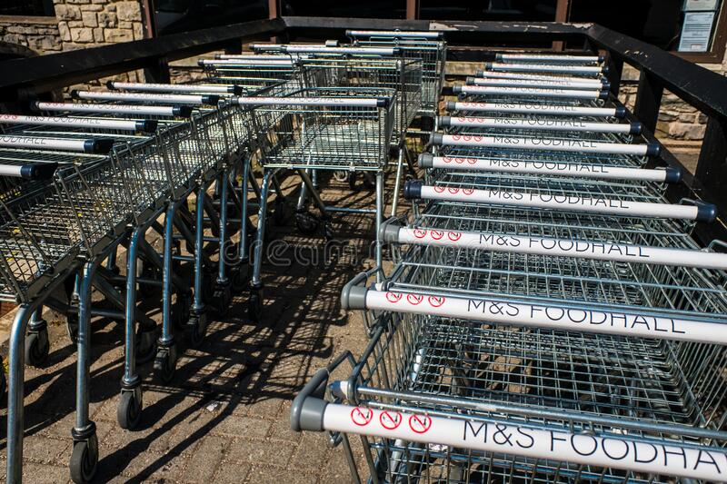 Row of M and S Foodhall trollies outside shop ready for shoppers to use stock photos