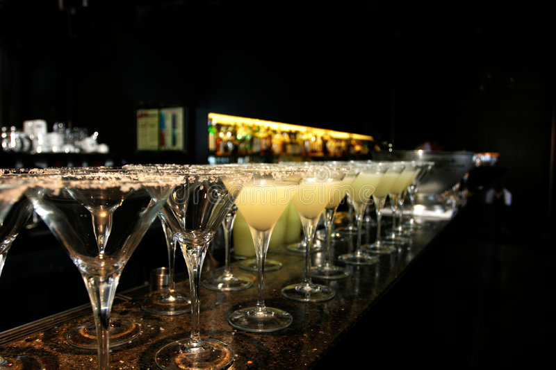 A row of margarita cocktails stock photo