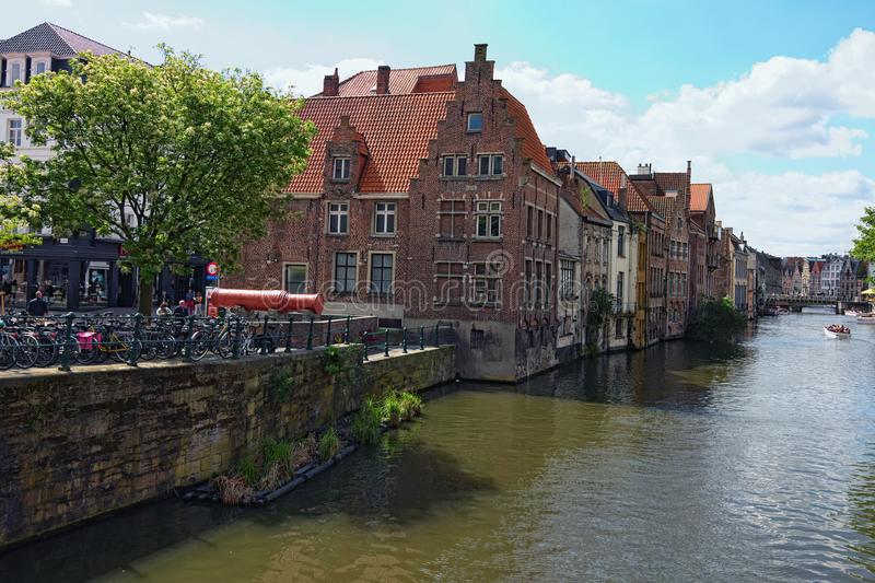 Row of medieval buildings along the Lys River. Little square with Big cannon The Mad Mag royalty free stock photography