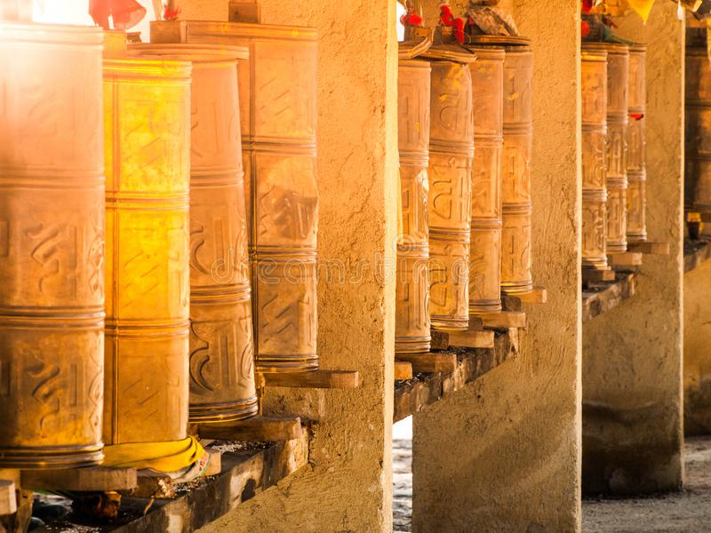 Row of metal prayer wheels. Traditional Tibetan Buddhist object royalty free stock photos
