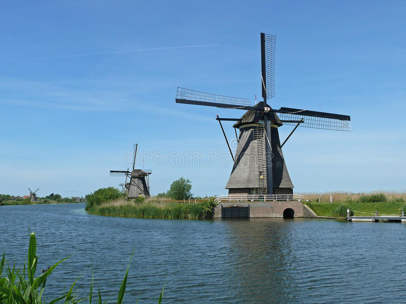 Row of mills in Kinderdijk, Netherlands. This cover nineteen mills in the northwest of the Alblasserwaard, in the Green Heart of Holland. Since 1997 they have stock image