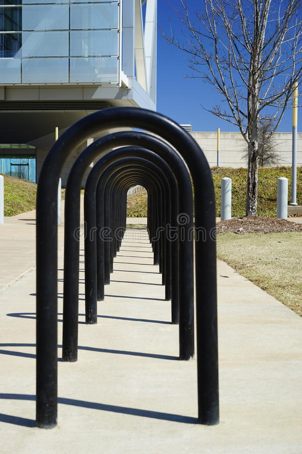 Row of modern bicycle racks. Bicycle racks encourage people to leave cars at home and get exercise stock image